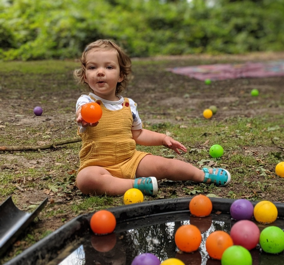 toddler_playing_with_coloured_balls